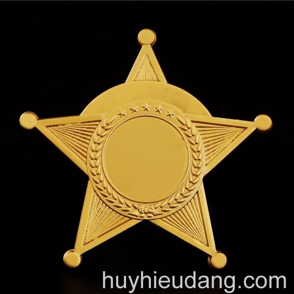 Huy hiệu đồng cài áo 1