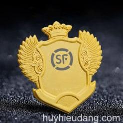 Huy hiệu đồng cài áo 7